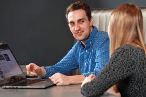 Review marketing expert with laptop
